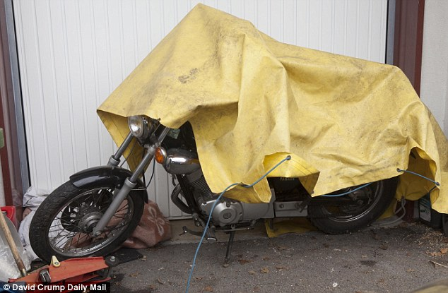 A motorbike outside the home of 48-year-old Eric Devouassoux in the village of Talloires. He was arrested on Monday