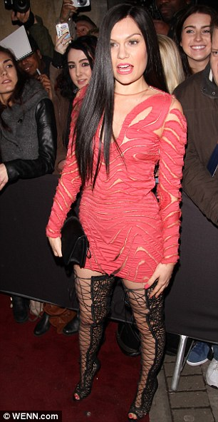 Fan fun: Jessie got close to her fans while posing on the red carpet - giving them quite the eyeful