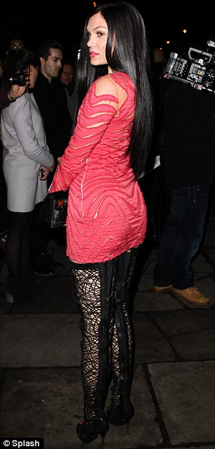Standing out: Even in the dark Jessie more than stood out in her daring ensemble
