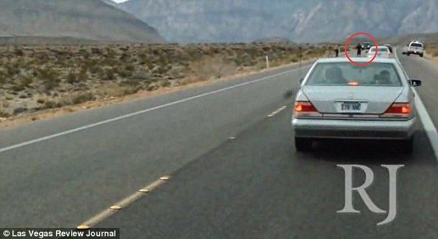 Put your hands up: The two men who filmed the shocking episode initially stopped and saw D'Andre Berghardt being held at gunpoint on  state Route 159 near Calico Basin, Nevada