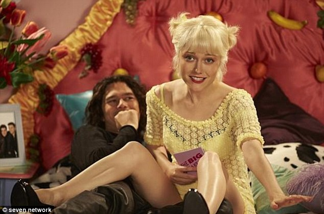 The moment they met: Georgina Haig plays Paula Yates and Luke Arnold is Hutchence, pictured recreating the moment the pair met on British TV personality Yates' show, The Big Breakfast