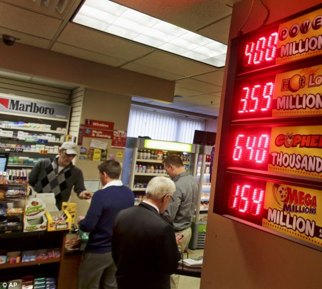The $400 miliion Powerball jackpot tops the list of lottery payouts in this convenience store in the Minneapolis skyway system yesterday