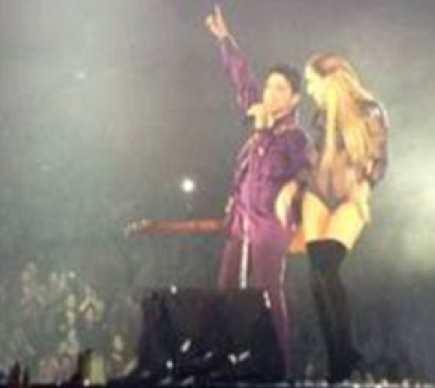 Performers: Delilah onstage with Prince during a concert on his Australian tour