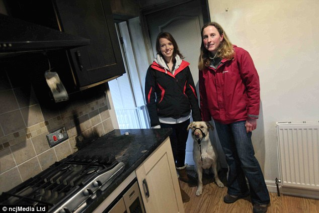 Smoke-damaged kitchen: Martey with Megan Campbell and dog walker Nicola Robinson (right) in Gateshead