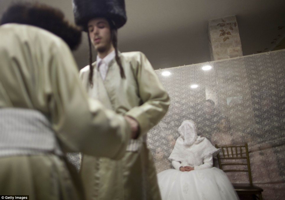 Secret lives: The women through white lace as Haredi traditions dictate that men and women are kept separate, some communities even arguing that married men and women should not be seen together