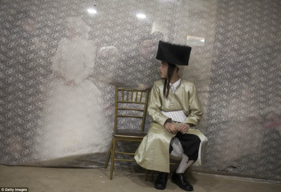 Nerves: Aharon Cruise turns around to see his young bride Rebecca approach from the women's side of the room, which is being separated by a veil