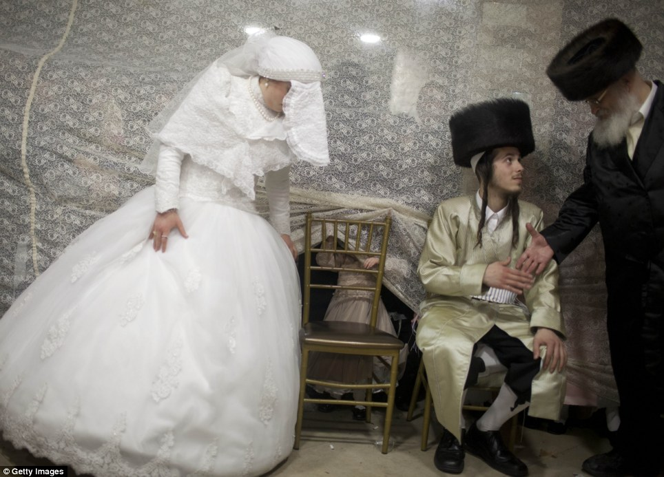 Aharon is wished good luck my a family member as Rebecca takes her seat next to him