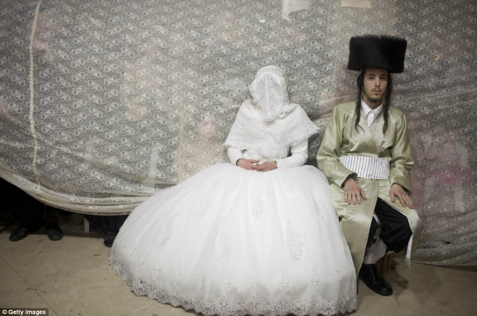 Traditional union: Ultra-Orthodox Jewish bride Rebecca Hanna and her groom Aharon Cruise sit after their wedding in the Mea Shearim neighborhood in Jerusalem
