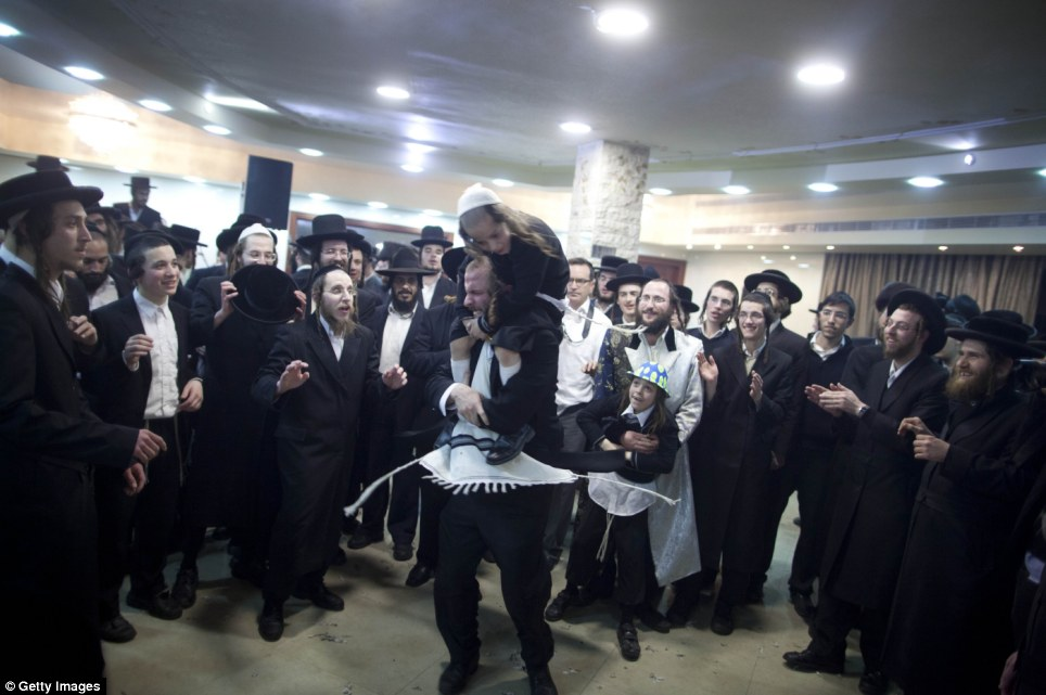 The know how to throw a party: The area of Mea Shearim, which means 100 gates, is one of the oldest Jewish neighbourhoods in Jerusalem, established in 1874, and has an overwhelmingly Haredi (ultra-orthodox Jewish) population
