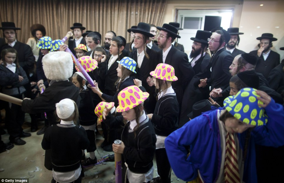 Modern society intervenes: In contrast, some of the younger guests changed their traditional hats for more modern headgear as the wedding celebrations went on into the night