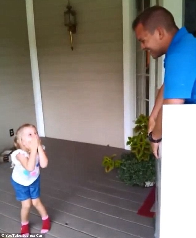 Surprise! In the video, Bridget opens her present and her father pops out with his hands in the air. 'Happy birthday!' he says, much to the delight of the little girl, who puts her hands over her face in surprise