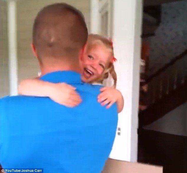 Emotional moment: The little girl's mother, who is recording the video, can be heard crying with joy in the background as Bridget clings onto her father, smiling uncontrollably