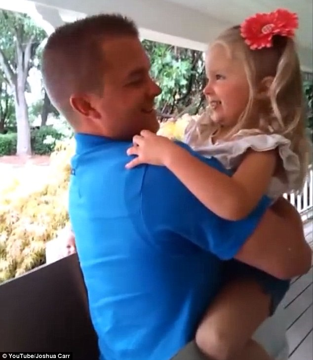 Striking a chord: The video, which bears the description: '#1 Perk of returning from Afghanistan around your 3 year old's birthday,' has had nearly 140,000 views since it was posted in September