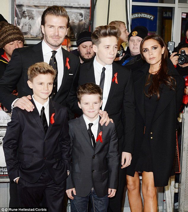 Guilt: Mother-of-four Victoria Beckham (with husband David and sons Romeo, Cruz and Brooklyn) admitted to Vogue last year that she feels 'guilty' every time she goes out to work