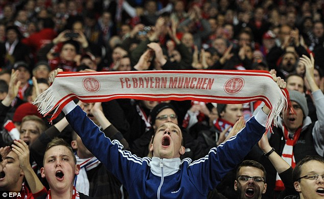 You're having a scarf: One Bayern fan looked to be particularly enjoying himself at the Emirates