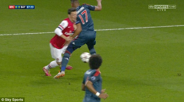 Penalty: Mesut Ozil goes down in the box after his skill beat Jerome Boateng all ends up
