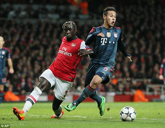 Catch him if you can: Bacary Sagna (left) attempts to tackle Bayern midfielder Thiago Alcantara