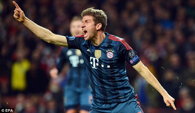 Game over? Thomas Muller screams with delight after his late header doubled Bayern's lead