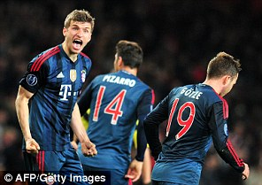 Bogeyman: Thomas Muller celebrates his second-half strike against Arsenal