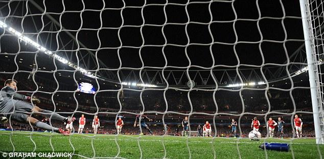 Woodwork: David Alaba's spot-kick strikes the post as Lukasz Fabianski dives the other way