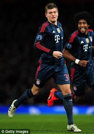 Toni Kroos celebrates his goal against Arsenal