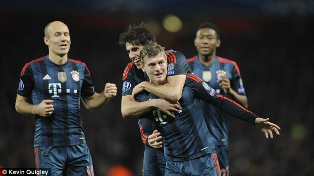 Main man: Kroos is congratulated by his team-mate Javi Martinez after opening the scoring