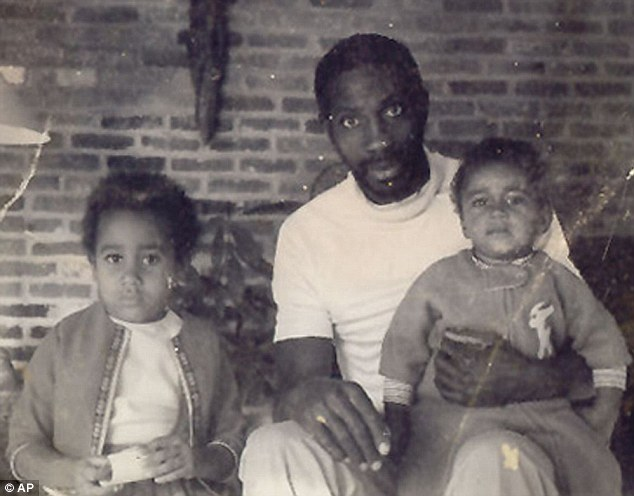 Tragic: This 1971 photo provided by the Robinson family shows civil rights activist Ray Robinson with his two oldest children, Desiree, left, and J. Marc at the family's farm at Bogue Chitto, Alabama. FBI documents have confirmed he was killed two years later at Wounded Knee