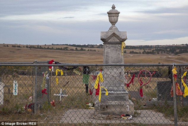 """Tortured: According to the FBI documents, an unidentified cooperating witness told agents that 'Robinson had been tortured and murdered within the AIM occupation perimeter, and then his remains were buried """"in the hills.""""' This image shows a monument in the town Wounded Knee, where Robinson went to help"""