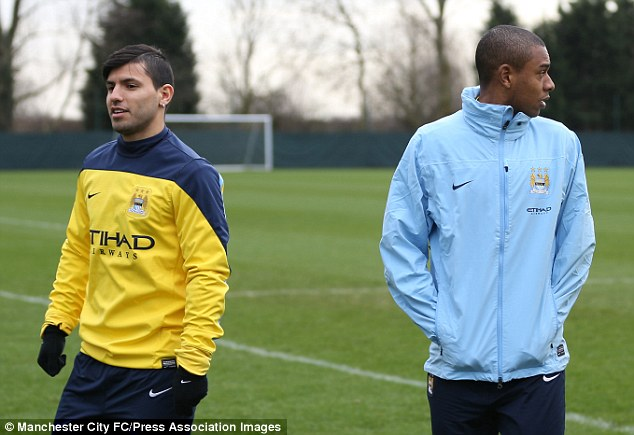 Road to recovery: Aguero recently returned to the training ground with another absentee Fernandinho (R)