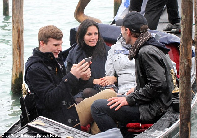 What a ride: Courteney and Johnny took a gondola ride just as it started to rain