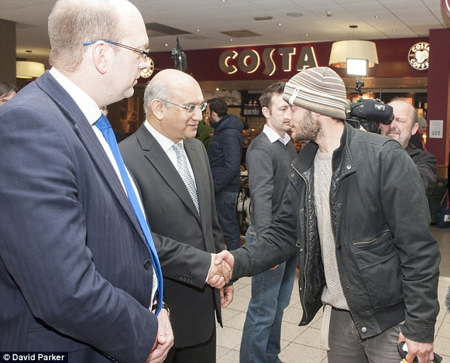 Romanian migrants arriving at Luton Airport on the first day since the lifting  of travel restrictions. MPs Mark Reckless (left) and Keith Vaz welcome Victor Spirescu, 30