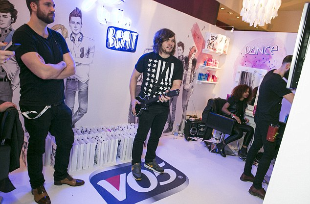 Rock on! Award winners Bastille popped into the V05 booth for a quick game of guitar hero