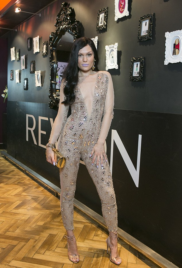 Lilac lady: Jessie J looked incredible in a Julien Macdonald jumpsuit as she popped into the Revlon booth of the spa for a manicure to match her lilac lips