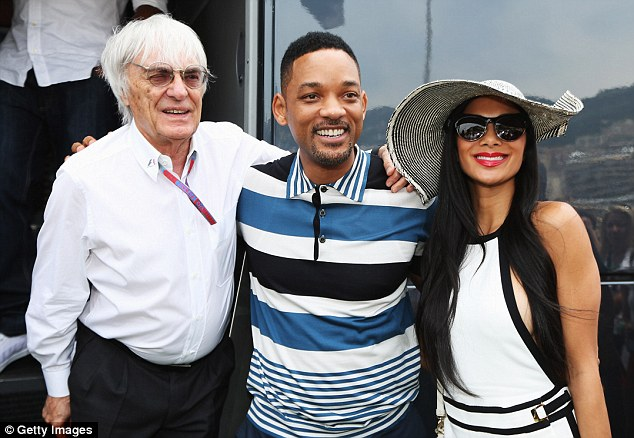 Famous faces: Ecclestone alongside Hollywood actor Will Smith and single Nicole Scherzinger