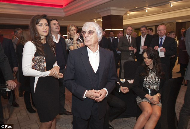Money man: Bernie Ecclestone was with his Brazilian wife Fabiana Flosi and daughter Tamara at the Zoom Formula 1 Charity Auction in London last week