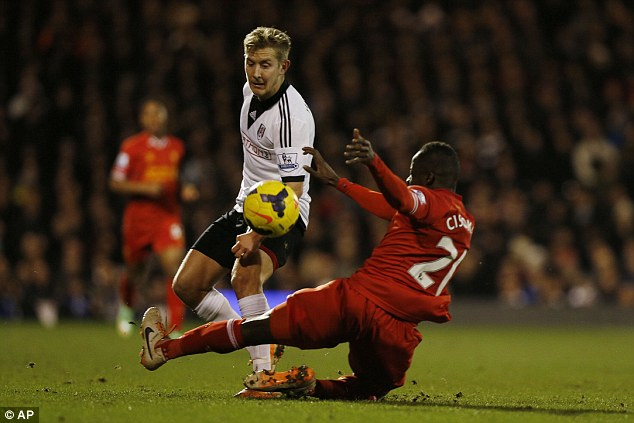 In action: Fulham, with Lewis Holtby (left) are rooted to the bottom of the Premier League