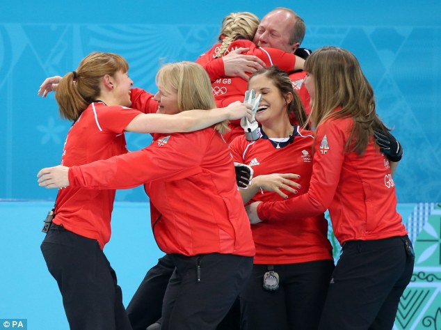 Team win: Great Britain's Claire Hamilton,left, hugs curling legend Rhona Howie as the team celebrate winning their match
