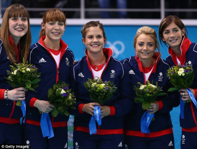 Winners: Bronze medalists Eve Muirhead, Anna Sloan, Vicki Adams, Claire Hamilton and Lauren Gray of Great Britain celebrate during the flower ceremony