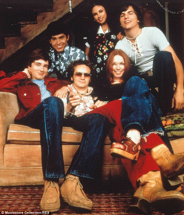 Eight years together: The cast of That '70s Show included Danny (center on couch) as well as Topher Grace, Wilmer Valderrama, Mila Kunis, Ashton Kutcher and Laura Prepon