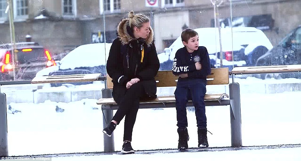 Caring: This young woman asks him why he has no coat in such cold weather. He replies that it was stolen