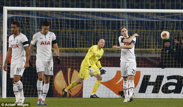 Shock: Spurs players walk back to the halfway line after conceding an 81st minute penalty against Dnipro