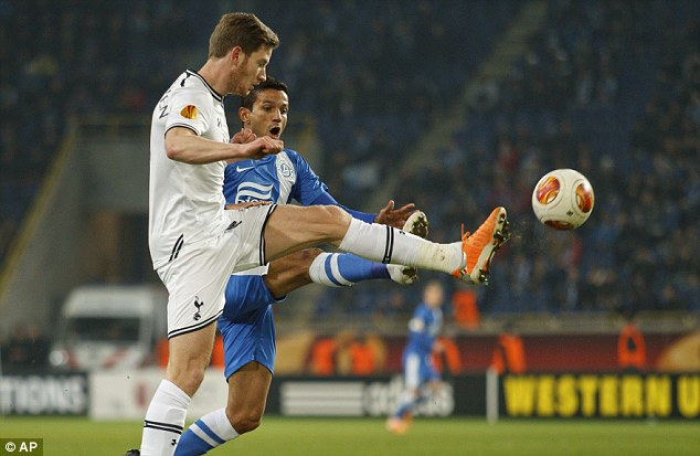 Tussle: Tottenham's Jan Vertonghen (left) challenges for the ball against Matheus during Dnipro's win