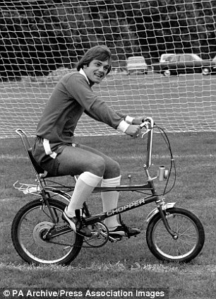 On your bike: Wilkins gets some leg exercise on a chopper bicycle