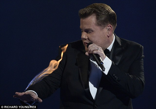 Brave: James did a number of stunts during the ceremony, even setting his arm on fire