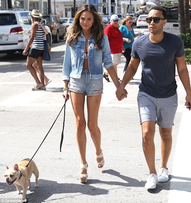 Taking care of business: The 28-year-old showed of her shapely legs as she and singer husband John Legend walked their dog before the event