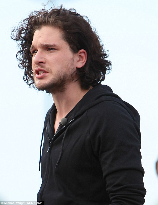 Blowing in the wind: Kit wore his signature long curly hair down during the interview