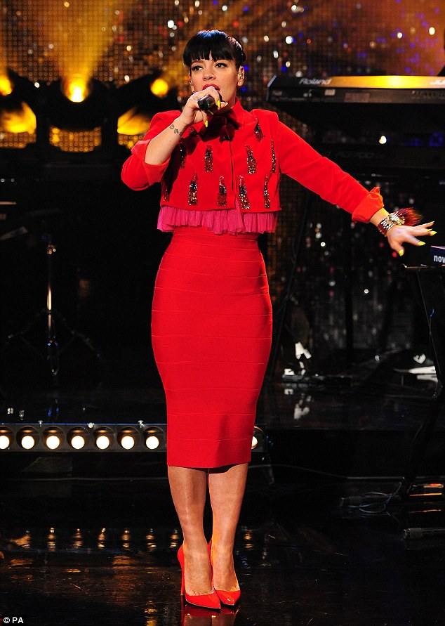 Where's she gone: Lily Allen shows off her ever-shrinking figure in a bodycon red skirt on The Graham Norton Show
