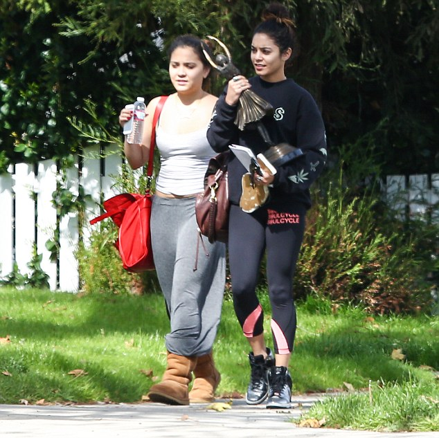 Here she comes: Vanessa Hudgens makes her way home with a friend after a spin session in Los Angeles on Thursday