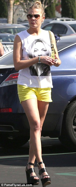 Hot to trot: The musician made her outfit even more eye-catching with these yellow hotpants
