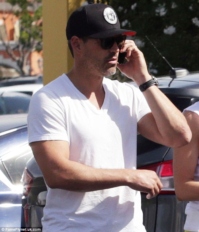 Phoning his lawyer? Perhaps he was discussing his legal woes with ex wife Brandi Glanville